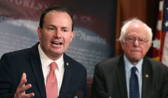 Republican Sen. Mike Lee of Utah is pictured with independent Sen. Bernie Sanders at a 2018 news conference.