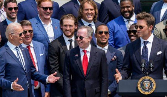 President Joe Biden gestures as Tampa Bay Buccaneers quarterback Tom Brady jokes Tuesday at the White House.