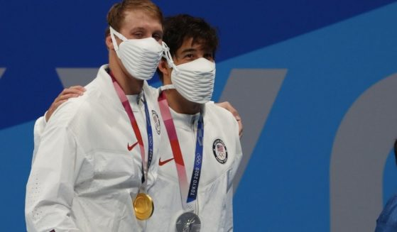 American swimmers Chase Kalisz and Jay Litherland celebrate their gold- and silver-winner performances Sunday in the men's 400m individual medley on day two of the Tokyo 2020 Olympic Games.