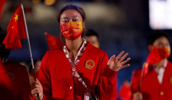 A member of China's delegation parades during the opening ceremony of the Tokyo 2020 Olympic Games, at the Olympic Stadium, in Tokyo on Friday.