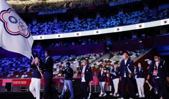 Athletes from Tawain, competing in the 2020 Summer Olympics as Team Chinese Taipei, enter Olympic Stadium in Tokyo during Friday's opening ceremonies.