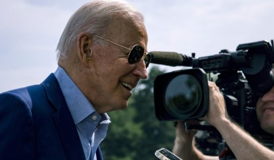President Joe Biden leans in to answer a question on the South Lawn of the White House on Sunday.