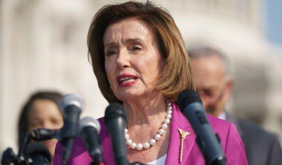 House Speaker Nancy Pelosi addresses an outdoor event Wednesday in Washington.