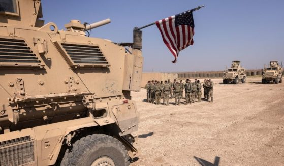 U.S. Army soldiers prepare for patrol at a remote combat outpost in northeastern Syria in a May file photo.