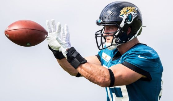 Tim Tebow of the Jacksonville Jaguars prepares to catch a pass during training camp in Jacksonville, Florida, on July 30, 2021.