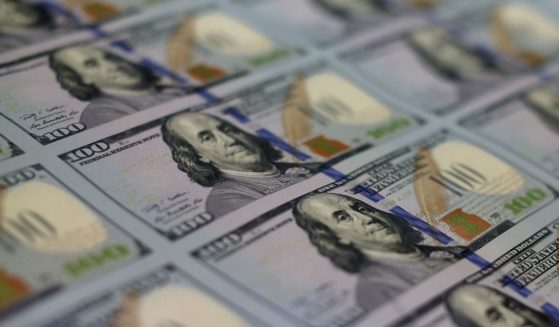 A stack of $100 bills held at the Bureau of Engraving and Printing in Washington, D.C., is seen in this May 20, 2013, photo.