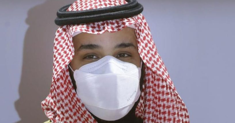 Saudi Crown Prince Mohammed bin Salman wears a face mask as he attends the Saudi Cup award ceremony during the final race of the $20 million, the Saudi Cup, at King Abdul Aziz race track in Riyadh, Saudi Arabia, on Feb. 20, 2021.