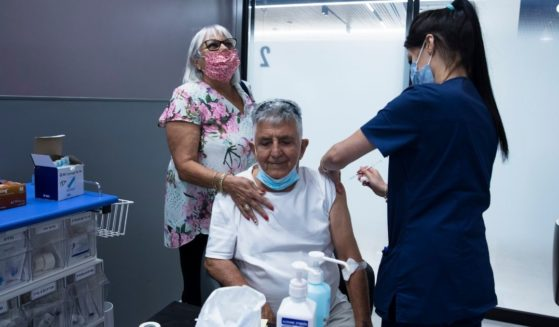 A leukemia patient receives his third dose of the COVID-19 vaccine at the Sheba Medical Center in Ramat Gan, Israel, on July, 14, 2021.