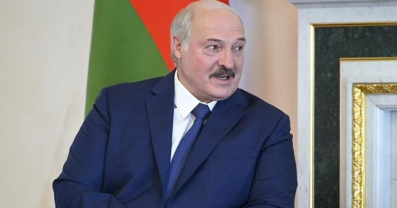 Belarusian President Alexander Lukashenko listens to Russian President Vladimir Putin during their meeting in St. Petersburg, Russia, on Tuesday.