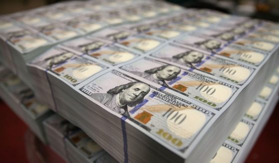 A bundle of $100 bills is seen lying in a stack at the Bureau of Engraving and Printing at Washington, D.C., in this photo taken on May 20, 2013.