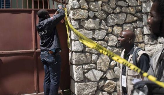 A security official cordons off access to the residence of late Haitian President Jovenel Moïse in Port-au-Prince, Haiti, on Wednesday.