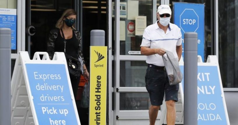 Shoppers are seen wearing face masks as they exit a Walmart store in Vernon Hills, Illinois, in this photo taken on Friday.