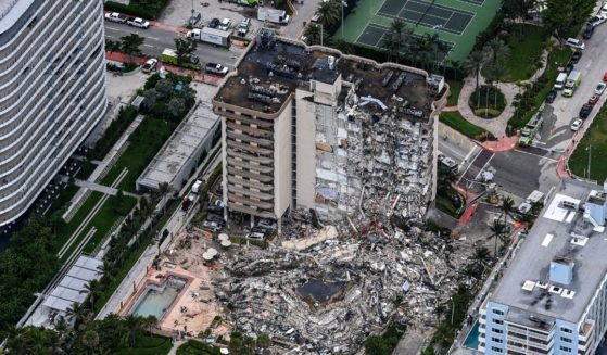 The partial collapse of the Champlain Towers South in Surfside, Florida, which occurred on June 24, 2021, is depicted in a photo showing an aerial point of view.