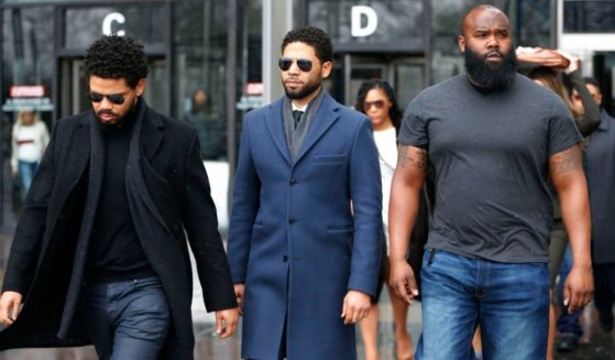 Actor Jussie Smollett, center, leaves Leighton Criminal Courthouse after his court appearance on March 14, 2019, in Chicago.