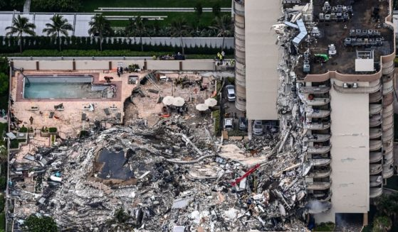 This aerial view shows search and rescue personnel working on site after the partial collapse of the Champlain Towers South in Surfside, north of Miami Beach, on June 24, 2021.