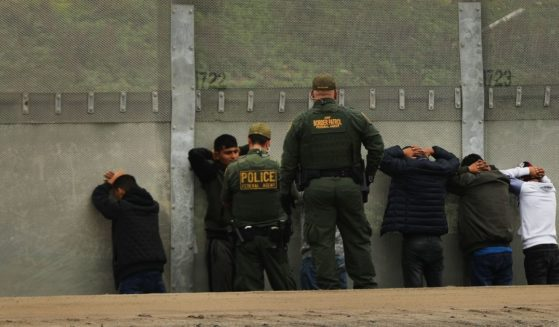 Men surrender to U.S. Border Patrol agents after jumping a fence in an attempt to get into the United States from Tijuana, Mexico, on Jan. 17, 2019.
