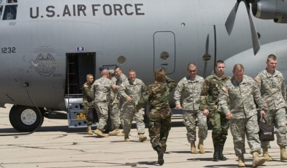 Members of the Kentucky National Guard 206th Engineer battalion arrive by C-130 Hercules transport plane on July 11, 2006, in Tucson, Arizona.