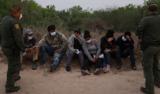 U.S. Border Patrol agents process a group of people they caught crossing the border from Mexico on March 27, in Penitas, Texas.