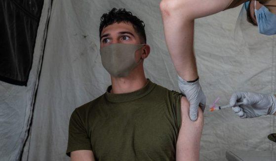 A U.S. Marine receives the Moderna coronavirus vaccine at Camp Foster on April 28, in Ginowan, Japan.