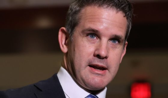 Illinois Republican Rep. Adam Kinzinger talks to reporters following a House Republican conference meeting in the U.S. Capitol Visitors Center in Washington on May 12.