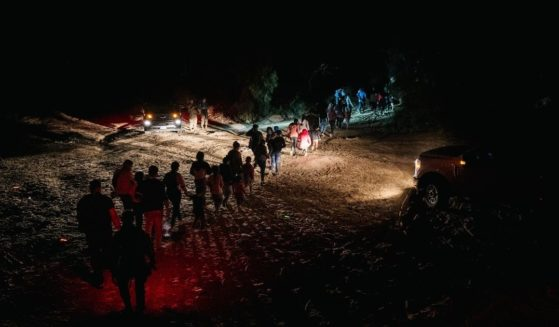 Border Patrol processes a group of migrants in Roma, Texas, after they illegally crossed the Rio Grande on Monday.