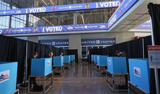 Voters use socially distanced voting machines set up in the east atrium of the United Center where a polling place with 70 machines was set up for the first time on Nov. 03, 2020, in Chicago.