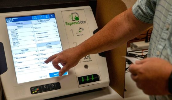 Mark Rhodes, county clerk of Wood County, West Virginia, shows the process of voting using new machines in Parkersburg on Oct. 21, 2020.