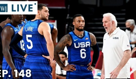 Coach Gregg Popovich of the USA talks to his players during the preliminary rounds of the Men's Basketball match between the USA and France on day two of the Tokyo 2020 Olympic Games at Saitama Super Arena on Sunday in Saitama, Japan.