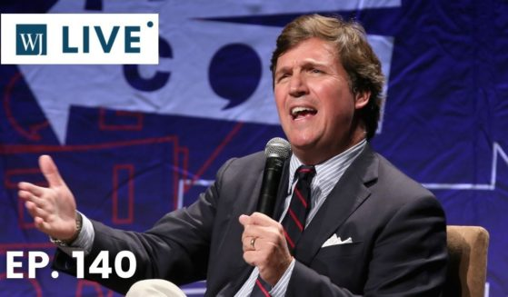 Tucker Carlson speaks onstage during Politicon at the Los Angeles Convention Center on Oct. 21, 2018.
