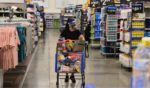 Customers wearing face masks shop at a Walmart retail store on July 16, 2020, in Pembroke Pines, Florida.
