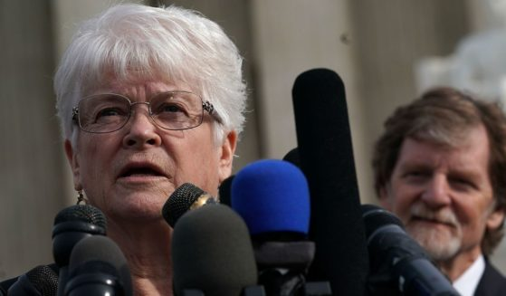 Floral artist Barronelle Stutzman, left, speaks to members of the media in front of the U.S. Supreme Court as cake artist Jack Phillips, right, looks on Dec. 5, 2017, in Washington, D.C.