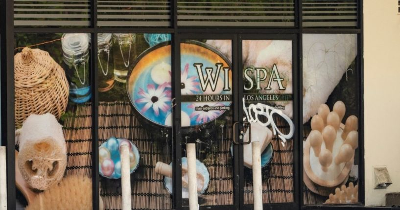 A vandalized window is seen at the Wi Spa in the Koreatown district of Los Angeles on July 4, 2021.