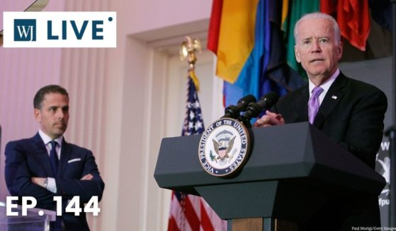 Then-Vice President Joe Biden speaks as his son, Hunter Biden, looks on during a World Food Program USA event at the Organization of American States in Washington on April 12, 2016.