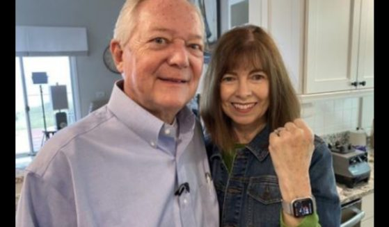 Diane Feenstra with her husband Gary and her Apple watch