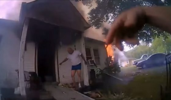 Bodycam footage from Officer Ervin, who raced into a burning house to save a disabled woman, is shown.