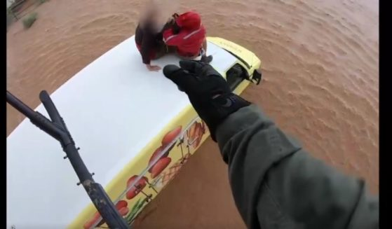 As floodwaters deluged parts of Arizona last week, a daring helicopter rescue plucked two people from a mobile home that was caught in fast-moving water.