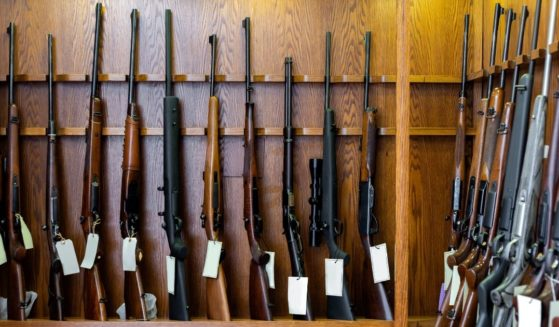 Guns are displayed in a store in this stock image.