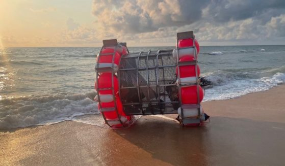 """Reza Baluchi's """"bubble,"""" a watercraft he hoped to take from Florida to New York, washed ashore Saturday."""