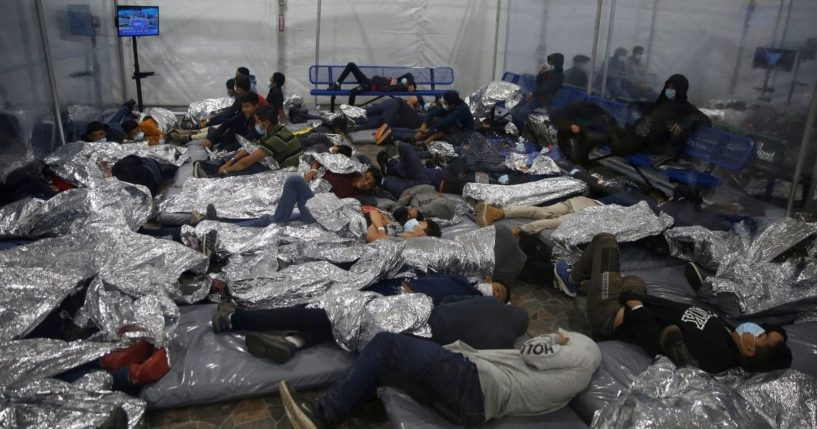 Children rest inside a Department of Homeland Security holding facility in Donna, Texas, on March 30, 2021.