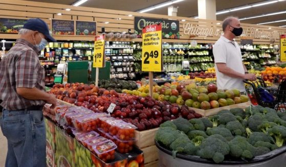 Customers shop for produce at a supermarket on June 10, 2021, in Chicago.