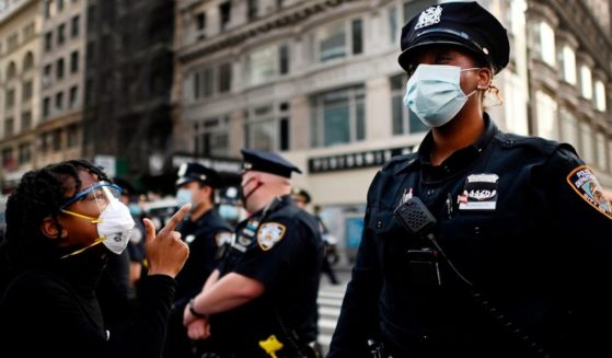 A protester shouts at a New York Police Department officer during a Black Lives Matter demonstration on May 28, 2020, in New York City.