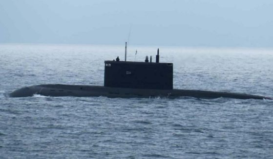 A Russian Kilo class submarine partially submerged.