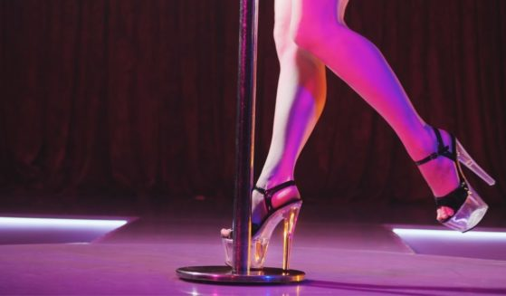 A dancer in a strip club is seen in the stock image above.