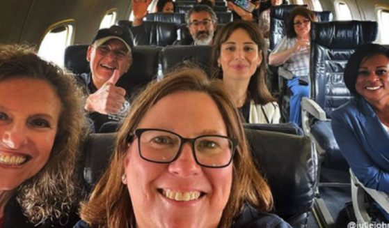 Democratic lawsmakers, none wearing masks, are pictured aboard a private plane while fleeing their state.