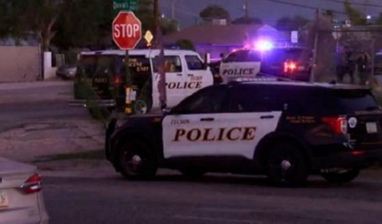 Police investigate a deadly shooting rampage in Tucson, Arizona, on Sunday.