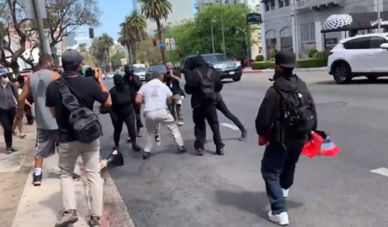 """Antifa thugs assault a man wearing a """"Trust Jesus"""" T-shirt Saturday during violence in Los Angeles."""