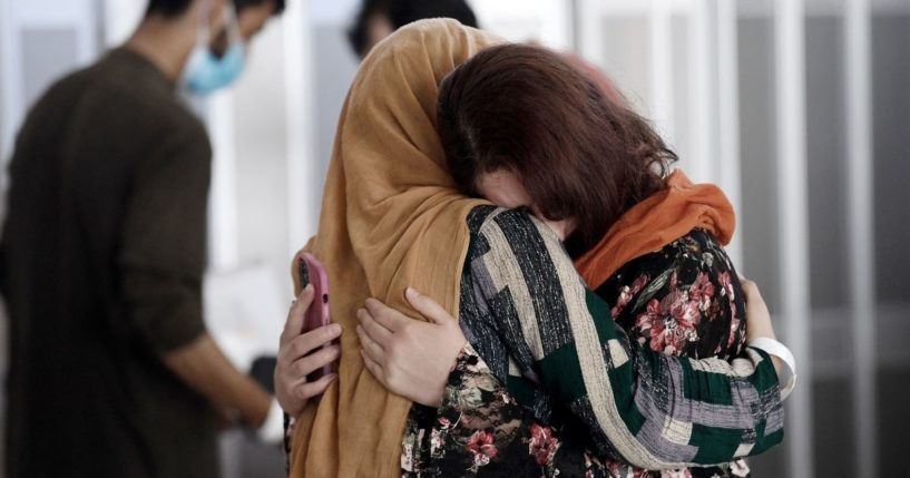 A woman embraces her sister-in-law as she arrives with other Afghan refugees on a flight at Dulles International Airport in Chantilly, Virginia, on Monday.