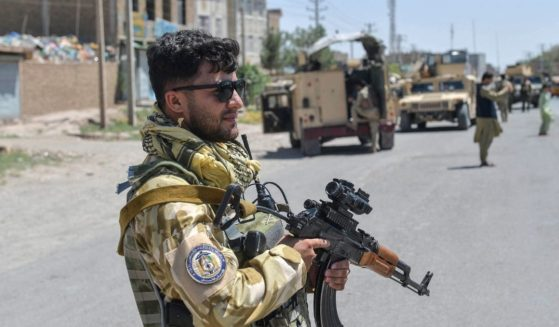 An Afghan National Army commando stands guard along the road in Enjil district of Herat province on Sunday as skirmishes between Afghan troops and Taliban forces continue.