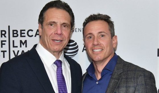 """Democratic New York Gov. Andrew Cuomo, left, and CNN anchor Chris Cuomo attend a screening of """"RX: Early Detection A Cancer Journey With Sandra Lee"""" during the 2018 Tribeca Film Festiva at SVA Theatre on April 26, 2018, in New York City."""