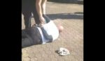 A man in Brisbane, Australia, is seen experiencing a medical emergency after being arrested, reportedly for not wearing a mask.